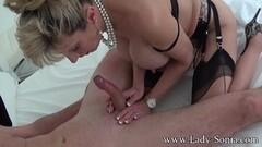 Busty blonde MILF Lady Sonia sucking off a masked man Thumb