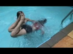 2 women playing in the swimming pool Thumb