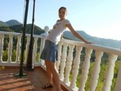 Super cute girl toying on the terrace Thumb