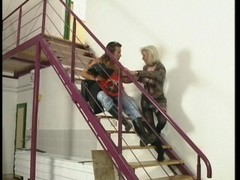Long haired fireman gets waylaid on steps by horny blonde Thumb