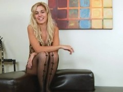 blonde with black pants and toy Thumb