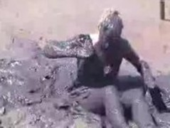 Clothed girl covered in mud Thumb