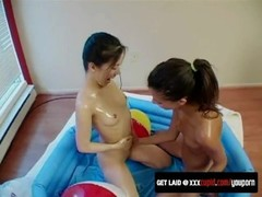 Cute Ladies Warm Each Other Up In Empty Pool With Toys Thumb