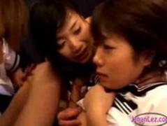 Two Asian Lesbian School Girls Kissing on Mattress Thumb
